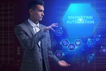 The concept of business, technology, the Internet and the network. A young entrepreneur working on a virtual screen of the future and sees the inscription: Marketing automation