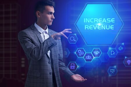 The concept of business, technology, the Internet and the network. A young entrepreneur working on a virtual screen of the future and sees the inscription: Increase revenue