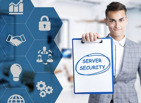 Business, technology, internet and network concept. Young businessman shows a keyword: Server security