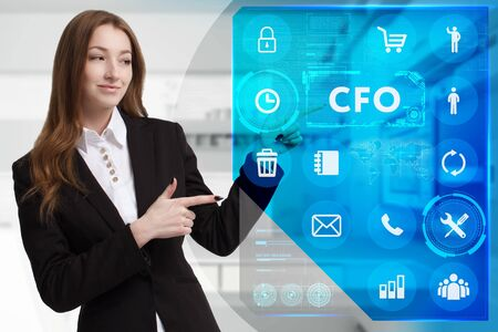 Business, Technology, Internet and network concept. Young businessman working on a virtual screen of the future and sees the inscription: CFO Stock Photo
