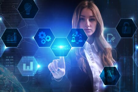 Business, Technology, Internet and network concept. Young businessman working on a virtual screen of the future and sees the inscription: Inventory management Stock fotó - 133489501