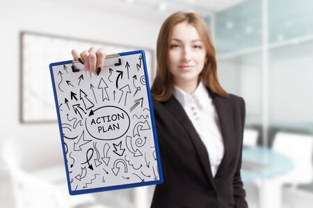 Business, technology, internet and network concept. Young businessman shows a keyword: Action plan Stock fotó - 133489509