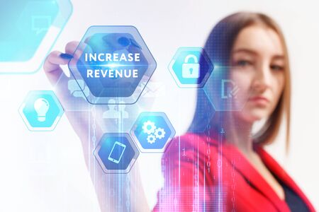 Business, Technology, Internet and network concept. Young businessman working on a virtual screen of the future and sees the inscription: Increase revenue