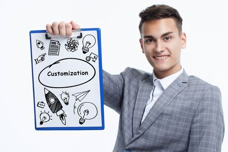 Business, technology, internet and network concept. Young businessman shows a keyword: Customization