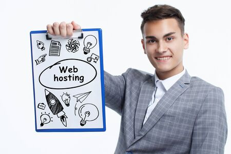 Business, technology, internet and network concept. Young businessman shows a keyword: Web hosting