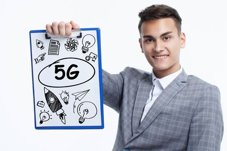 Business, technology, internet and network concept. Young businessman shows a keyword: 5G