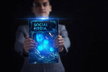 Business, Technology, Internet and network concept. Young businessman working on a virtual screen of the future and sees the inscription: Social media Banque d'images - 133854614