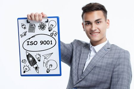 Business, technology, internet and network concept. Young businessman shows a keyword: ISO 9001 Banque d'images - 133854609