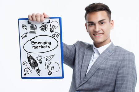 Business, technology, internet and network concept. Young businessman shows a keyword: Emerging markets Banque d'images - 133854745