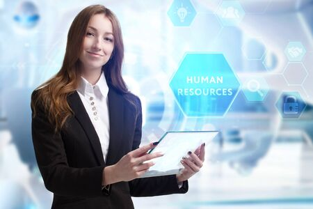 Business, Technology, Internet and network concept. Young businessman working on a virtual screen of the future and sees the inscription: Human resources