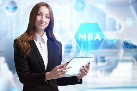 Business, Technology, Internet and network concept. Young businessman working on a virtual screen of the future and sees the inscription: MBA