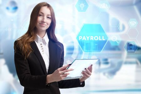 Business, Technology, Internet and network concept. Young businessman working on a virtual screen of the future and sees the inscription: Payroll Banco de Imagens