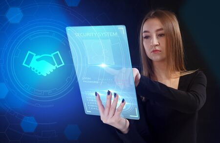 Business, Technology, Internet and network concept. Young businessman working on a virtual screen of the future and sees the inscription: Reklamní fotografie - 135497245