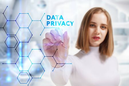 Business, Technology, Internet and network concept. Young businessman working on a virtual screen of the future and sees the inscription: Data privacy