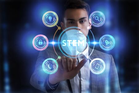 Business, Technology, Internet and network concept. Young businessman working on a virtual screen of the future and sees the inscription: