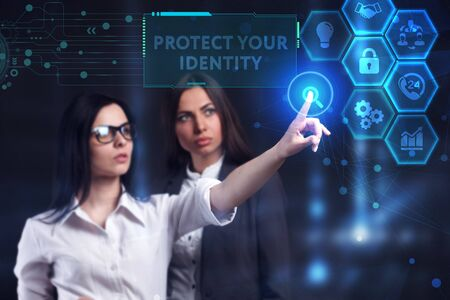 Business, Technology, Internet and network concept. Young businessman working on a virtual screen of the future and sees the inscription: Protect your identity Stock Photo