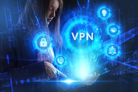 Business, Technology, Internet and network concept. Young businessman working on a virtual screen of the future and sees the inscription: VPN Stock Photo