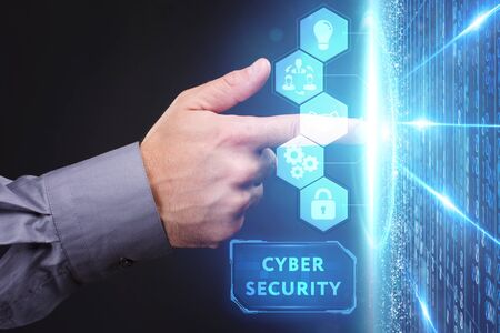 Business, Technology, Internet and network concept. Young businessman working on a virtual screen of the future and sees the inscription: cyber security 版權商用圖片