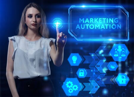 Business, Technology, Internet and network concept. Young businessman working on a virtual screen of the future and sees the inscription: Marketing automation