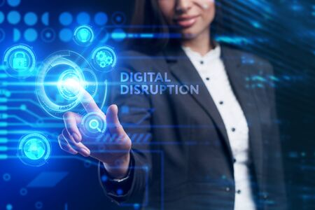 Business, Technology, Internet and network concept. Young businessman working on a virtual screen of the future and sees the inscription: digital disruption Banco de Imagens