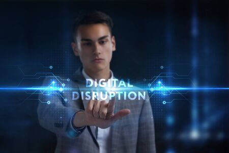 Business, Technology, Internet and network concept. Young businessman working on a virtual screen of the future and sees the inscription: digital disruption Фото со стока