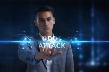 Business, Technology, Internet and network concept. Young businessman working on a virtual screen of the future and sees the inscription: Ddos attack Фото со стока