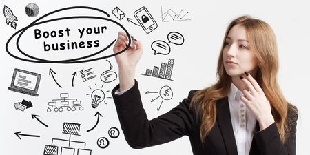 Business, technology, internet and network concept. Young businessman thinks over ideas to become successful: Boost your business