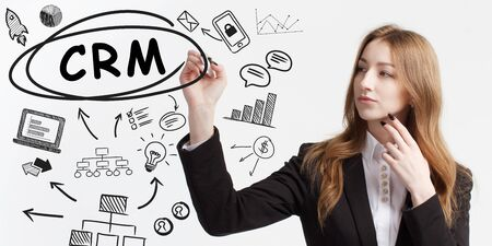 Business, technology, internet and network concept. Young businessman thinks over ideas to become successful: CRM