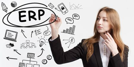 Business, technology, internet and network concept. Young businessman thinks over ideas to become successful: ERP