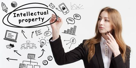 Business, technology, internet and network concept. Young businessman thinks over ideas to become successful: Intellectual property