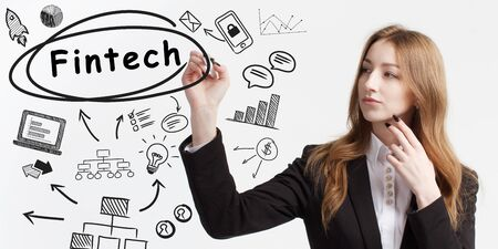 Business, technology, internet and network concept. Young businessman thinks over ideas to become successful: Fintech