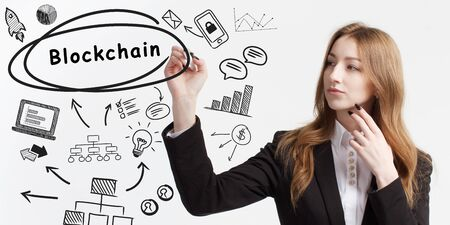 Business, technology, internet and network concept. Young businessman thinks over ideas to become successful: Blockchain
