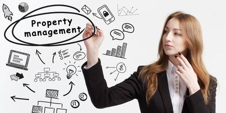 Business, technology, internet and network concept. Young businessman thinks over ideas to become successful: Property management