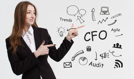 Business, technology, internet and network concept. Young businessman thinks over ideas to become successful: CFO Stock Photo