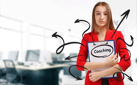 Business, technology, internet and network concept. Young businesswoman shows a keyword: Coaching