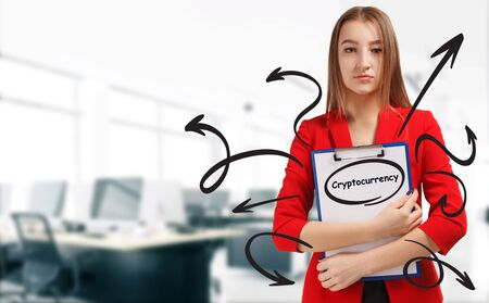Business, technology, internet and network concept. Young businesswoman shows a keyword: Cryptocurrency