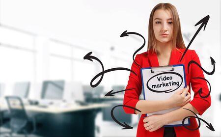 Business, technology, internet and network concept. Young businessman shows a keyword: Video marketing Reklamní fotografie