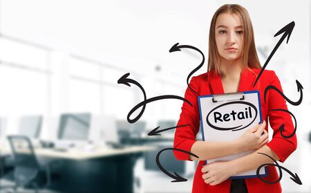 Business, technology, internet and network concept. Young businessman shows a keyword: Retail