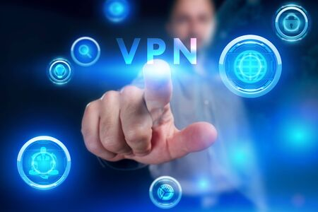 Business, Technology, Internet and network concept. Young businessman working on a virtual screen of the future and sees the inscription: VPN Archivio Fotografico - 149594689