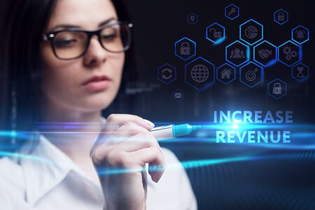 Business, Technology, Internet and network concept. Young businesswoman working on a virtual screen of the future and sees the inscription: Increase revenue Stock fotó