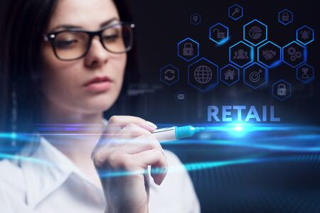 Business, Technology, Internet and network concept. Young businesswoman working on a virtual screen of the future and sees the inscription: Retail Stock fotó