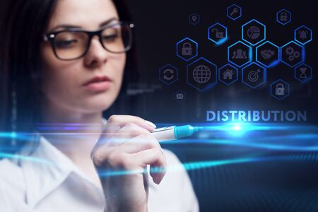 Business, Technology, Internet and network concept. Young businesswoman working on a virtual screen of the future and sees the inscription: Distribution