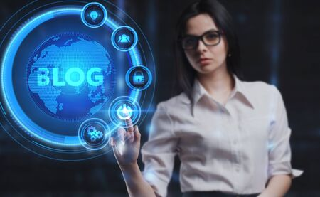 Business, Technology, Internet and network concept. Young businesswoman working on a virtual screen of the future and sees the inscription: Blog Stock fotó