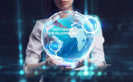 Business, Technology, Internet and network concept. Young businessman working on a virtual screen of the future and sees the inscription: Software development Zdjęcie Seryjne