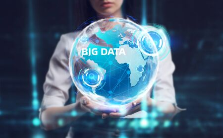 Business, Technology, Internet and network concept. Young businessman working on a virtual screen of the future and sees the inscription: Big data Фото со стока