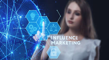 Business, Technology, Internet and network concept. Young businesswoman working on a virtual screen of the future and sees the inscription: Influence marketing