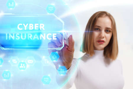 Business, Technology, Internet and network concept. Young businesswoman working on a virtual screen of the future and sees the inscription: Cyber insurance