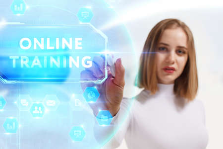 Business, Technology, Internet and network concept. Young businesswoman working on a virtual screen of the future and sees the inscription: Online training