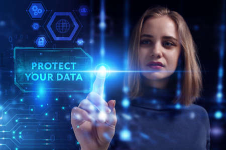 Business, Technology, Internet and network concept. Young businesswoman working on a virtual screen of the future and sees the inscription: Protect your data 스톡 콘텐츠