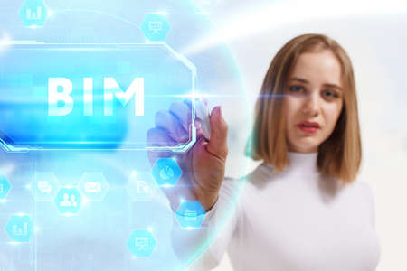 Business, Technology, Internet and network concept. Young businesswoman working on a virtual screen of the future and sees the inscription: BIM